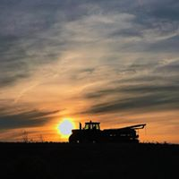 Tractor in the sunset, celebrating the Tour de Farm
