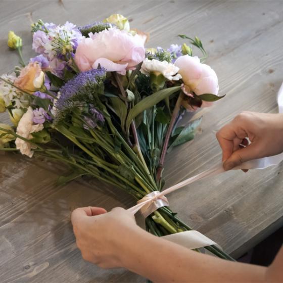 Hands Tying a Bouquet