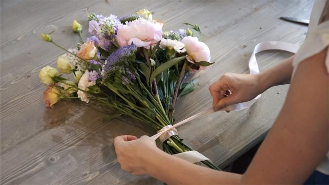 Process Of Creating Bouquet Florist Flower Shop Close-up. Woman